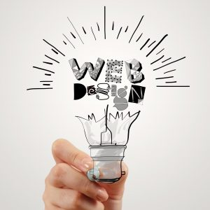 hand drawing light bulb and WEB DESIGN word design as concept